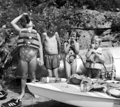 Cousins (F. Neil S.) Tags: newyork film monochrome 35mm children blackwhite dock adirondacks upstateny lakegeorge negative grapes sunfish blancetnoir contaxaria selfdev dunhamsbay