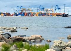 Natural beauty meets the modern trade (KaarinaT) Tags: nature finland helsinki rocks colorful juxtaposition vuosaari cargoport natureversusindustry