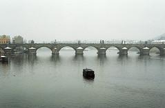 Bridge (Toffee Maky) Tags: city bridge winter snow slr film water analog 35mm prague grain pentaxk1000 analogue expired analogslr smcpentaxm1250mm agfacolor200 agfafilms toffeemaky