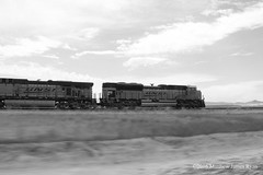 High Plains, High Iron (Wanderer Photography) Tags: santa county railroad light sky white black blur west metal clouds burlington contrast speed train prime evening moving high nebraska iron long afternoon action steel empty south north engine rail railway ne east neb short western locomotive fe coal northern empties ge load bnsf westbound mover loads evo loaded northbound southbound eastbound emd gevo sd70 sd70ace es44ac