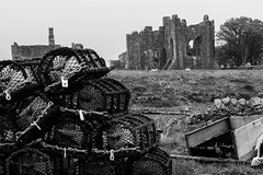 Lobster Pots and the Priory - Lindisfarne (Iamamanc) Tags: blackandwhite monochrome sheep ruin pot northumberland holyisland lindisfarne grazing priory lobsterpots manfrotto adrianfortune sonyalphaa77 sony1650mmf28 adrianfortuneskycom