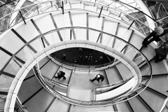 City Hall Staircase (Cris Ward) Tags: city uk blackandwhite bw abstract building london art public glass monochrome thames architecture modern stairs contrast digital project river spiral mono office construction riverside mayor britain cityhall interior sony wide descent kitlens monotone indoors event staircase walkway enthusiast 1855mm alpha dslr passage riverbank amateur openhouse southwark circular beginner greyscale a450 opencitylondon2013