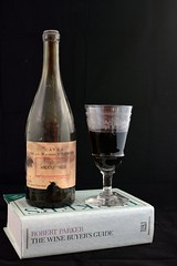half empty or half full? (The Urban Adventure) Tags: paris france glass 35mm vintage french bottle nikon wine vin maison 1928 anjou avenuevictorhugo robertparker nikon35mm d7100 rarewine parkersguide