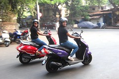 Two little Honda's... (Yazed Lord) Tags: ladies red smile bike lady female mar women purple rally helmet smiles bikes parade jeans enjoy dio mumbai 2014 activa vision:outdoor=0699 vision:car=0867