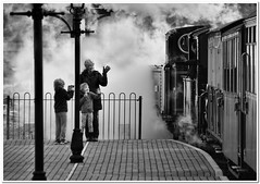 Capturing the moment (Hugh Stanton) Tags: travel station train mom daughter wave son steam tablet