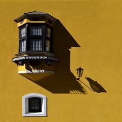 The other FACE - Bow window (Nespyxel) Tags: light window lamp face yellow architecture facade square design shadows ombre finestra giallo architettura luce vipiteno lampione quadrato mustardyellow geometrie facciata geometries bowwindow trentinoaltoadige bovindo nespyxel stefanoscarselli