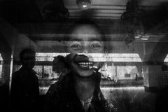 An expected smiely (najmul_nahid) Tags: reflection glass smile kids train canon eid happiness journey goinghome dhaka potrait beautifuleyes bnw throughtheglass travelphotography kamlapurrailway najmulnahid