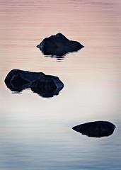 Sea of Pink and Blue (trm42) Tags: morning pink blue sea nature silhouette sunrise suomi finland spring helsinki rocks pastel meri lauttasaari kevt aamu kivet