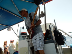 Glass Bottom Boat Captain plays Pink Floyd (deltrems) Tags: pink people woman man men glass island greek person boat women mediterranean guitar bottom pinkfloyd greece captain floyd med rhodes guitarist janos