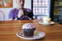 Photographing the Cupcakes (sea turtle) Tags: seattle camera pink photographer coconut bokeh chocolate cupcake ballard cupcakeroyale michaelchuck coconutbunny