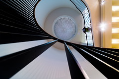Look! (Maerten Prins) Tags: shadow abstract geometric up yellow museum architecture stairs germany circle spiral person stair looking or steps cologne down kln dot stairwell step railing dots curve duitsland keulen makk explored museumfrangewandtekunst