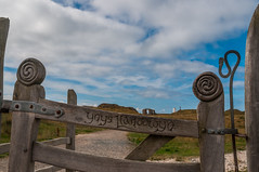 Gateway to paradise... (Lee~Harris) Tags: uk sky cloud beautiful clouds landscape wooden gate carving distance anglesey