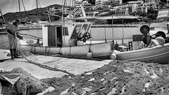 Fixing the nets (Septro) Tags: sea summer blackandwhite bw sun island mono fisherman outdoor greece nets kythnos