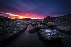Blue Evening Sunset (Arvid Bjrkqvist) Tags: ocean longexposure pink blue red sea sky orange water colors yellow clouds reflections dark coast rocks mood sweden gothenburg vivid bluehour torslanda tumlehed