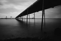 Summer Storm At The Dock (Dan Constien) Tags: longexposure summer blackandwhite lake storm water wisconsin clouds minolta 28mm madisonwisconsin lakemendota weldingglass sonya7 danconstien