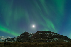 Aurora borealis over the mountain in Iceland (Goldsaint) Tags: travel light sky moon mountain green tourism nature beautiful night landscape lights star solar iceland scenery natural outdoor background north arctic aurora summit astronomy geography polar northern magnetic borealis phenomenon geological