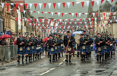 and the band played singing in the rain (BRYANJOHNSTONE) Tags: music rain weather flags peebles marching kilts tartan pipeband scottishborders pipemajor