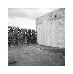 reality shift (ha*voc) Tags: urban bw 120 6x6 film monochrome mediumformat square doubleexposure mundane zandvoort urbanfragments ilforddelta100 id11 rolleiflex35f carlzeissplanar75mmf35
