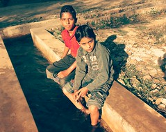 Boys will be boys!  :) (farrukhathar) Tags: park morning winter friends pakistan game boys water childhood kids fun gallo nokia stream memories sunny calm past lahore 2012 n73