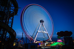 Spinning (Ian Allon) Tags: longexposure england wheel zeiss lights amusement ride fairground unitedkingdom sony gb lighttrails bluehour bigwheel newcastleupontyne townmoor thehoppings leefilters a6000 bigstopper
