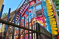 On the Bright Side (AntyDiluvian) Tags: cambridge house building boston fence bright painted massachusetts fireescape massave massachusettsavenue brightpaint brightlypainted