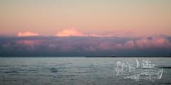 the sky is bruised (goodgirlbetty) Tags: ocean sunset sky water rain weather clouds pier sundown qld storms bruised sandgate