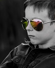 Six going on Sixteen (Marc.Dion) Tags: boy bw face sunglasses cool bad stare six tough
