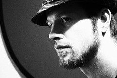 Self (The Infamous Blue Tie) Tags: portrait bw white black wall self beard side profile picture screen fedora
