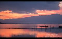Beautiful sunset on Kwan Phayao Lake in Phayao, Thailand (jitenshaman) Tags: travel sunset sky sun lake color colour nature water clouds landscape asian thailand boat scenery asia colours paddle peaceful thai oar destination serene roar kwanphayao phayao worldlocations phayaolake
