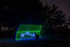 Bike Movie (~138~) Tags: park longexposure blue light canada lightpainting abstract colour green art colors bike night dark movie fun evening cool nightlights awesome curves paintingwithlight trippy lightart shadowpeople singleexposure
