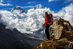 Breathless (TranceVelebit) Tags: above nepal woman snow mountains clouds view hiking snowy stones buddhist cumulus mountaineering hiker np peaks himalaya khumbu himalayas prayers thamserku glacial aboveclouds sagarmatha kangtega