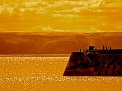 Sepia Sea (Pufalump) Tags: sea sky brown lighthouse yellow sepia wales landscape fishing fishermen silouhette porthcawl wate