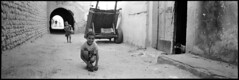 Boy with kitten. Tunisia (tonywright617) Tags: 120 film children kitten village tunisia panoramic hp5 analogue ilford fujica g617
