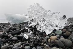 Jkulsrln - Glacier Lagoon (Claire Willans) Tags: sea cold macro ice beach nature water coast iceland stones pebbles glacier jokulsarlon jokulsarlonglacierlagoon