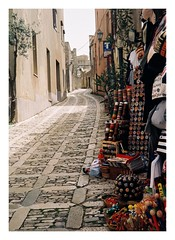 Erice (joaofreitas) Tags: street old italy film tourism shop stone analog outdoors holidays traditional olympus cobblestone souvenir sicily erice