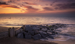 Red Dawn (scott.hammond34) Tags: red sea sky orange seascape beach water clouds sunrise landscape golden suffolk rocks waves outdoor vivid groyne southwold seadefences
