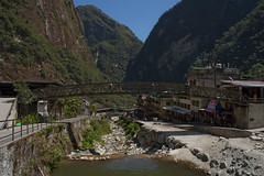 A bridge for Aguas Caliente (Bahanick (Nxt Up: the trip to Machu)) Tags: park camera original light white black art alpaca nature colors up look machu inca cuzco composition contrast train work trek dark de for site reflex amazon rainforest raw foto with arte bright image lima good cusco poor picture shapes dirty per pichu trail national saturation su lama visual manu emotions per curiosity colori con luce madre disease outskirts dios forme archeological sensation riflesso composizione ande scuro sensazioni immagine emozioni chiaro tonality visivo