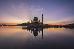 Putra (adamraufz.inc) Tags: travel light sky cloud lake reflection building architecture sunrise landscape religious dawn worship ray background steel muslim islam faith religion pray landmark mosque holy malaysia dome editorial islamic