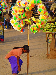 Windmill salesgirl (jonhuskisson) Tags: india beach windmill girl asia bombay mumbai sales selling chowpatty girgaum girgaumchowpatty