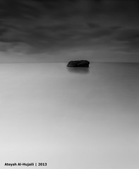 Single rock (Ateyah J. Hujaili) Tags: sky bw cloud white black beach rock photoshop canon lens landscape photography lights photo aperture long exposure jay photographer gray reflected saudi arabia mm 1855mm 1855 yanbu    canon600d ateyah ateyahjay