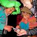 Andean Girls Looking at Photos of Their Friends - Lares Trek, Peru, G Adventures