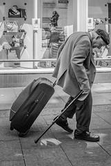 street monochrome shop suffolk nikon oldman luggage walkingstick elderly burystedmunds flatcap adobelightroom thetraverse nikon1v1 1nikkor10mmf28