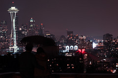 Lovers at Kerry Park (coofee) Tags: seattle park longexposure rain skyline night downtown cityscape kerry romance lovers rainy pacificnorthwest ferriswheel spaceneedle kerrypark