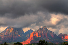 Storm Over Sedona (aeneas66) Tags: park travel blue trees red arizona sky orange mountain storm southwest nature rock clouds rural america dark landscape sandstone desert natural bright sedona canyon erosion formation pines weathered geology geological
