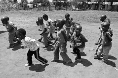 Kids on the playground (Terra eVita) Tags: africa travel viaje school boy people urban bw playing girl playground kids children southafrica mono town blackwhite kid nikon village child candid streetlife monotone teacher elim limpopo kindergarden ribollaartsroute