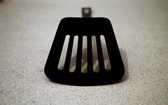 spatula (gaypunk) Tags: food black cooking kitchen metal silver counter plastic flip tool slots