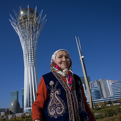 Old Woman In Front Of Baiterek Tower, Astana, Kazakhstan (Eric Lafforgue Photography) Tags: old portrait people building tower monument architecture female standing square outside outdoors person exterior veiled veil capital hijab bluesky structure elder lollipop centralasia kazakhstan kazakh modernarchitecture humanbeing sights easterneurope astana contemplation nationalarchives lookingatcamera waistup squarepicture lowangleshot eggshape islamicveil lookingcamera akmola baiterektower akmolinsk bigchupachups eggshapednationalarchives eggshapped kz9232