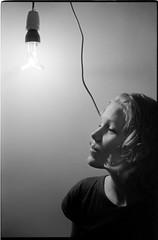 (Bourguiboeuf) Tags: light party portrait people bw woman white black france color slr film girl monochrome face bulb lady canon french 50mm reflex noir fuji grain f1 ampoule nb blond fete 400 portraiture blonde l fujifilm neopan mm analogue 135 soire 35 et blanc gens tete visage argentique fd f12 pellicule bourguiboeuf