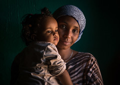Sufi mother with her baby, Harari region, Harar, Ethiopia (Eric Lafforgue) Tags: africa travel portrait people woman baby color childhood horizontal female scarf outdoors women toddler child adult african muslim islam religion headscarf mother lifestyle indoor unescoworldheritagesite indoors shawl ethiopia sufi sufism 2people twopeople carrying hornofafrica ethiopian eastafrica thiopien harar etiopia abyssinia ethiopie etiopa harari  etiopija ethiopi  africanculture etiopien etipia  etiyopya     harariregion      ethio162906