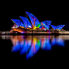 Blue veil (silardtoth) Tags: ocean new city travel urban house color building art water beautiful closeup wales architecture night lights bay harbor opera theater cityscape harbour background south famous central sydney sails vivid australia circularquay landmark icon quay nsw newsouthwales cbd operahouse lightshow iconic circular